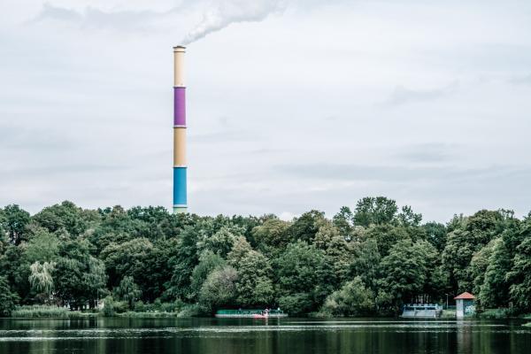 industrial emission beyond lake scene