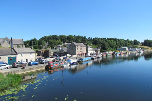 View across water towards canal boats and buildings