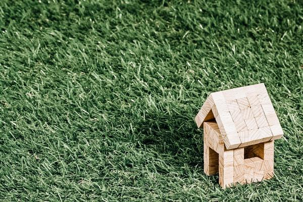 mini wooden house on grass