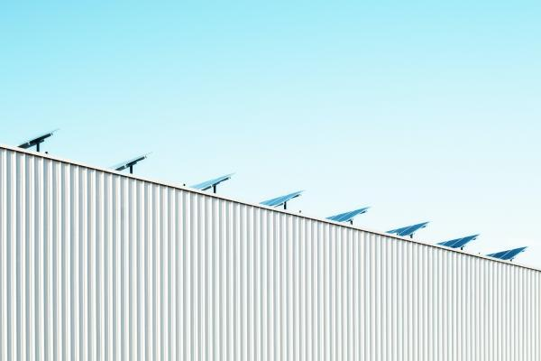 industrial building with solar panels on roof