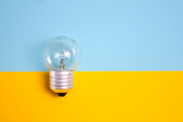 blue and yellow block colour background with lightbulb