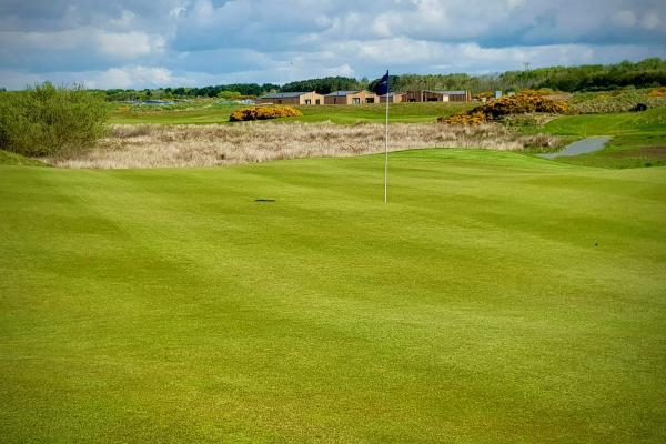 Lodges visible across golf course