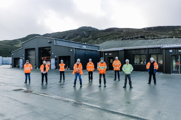 Duntanlich mining team - showing 9 people in high-vis jackets posing for picture