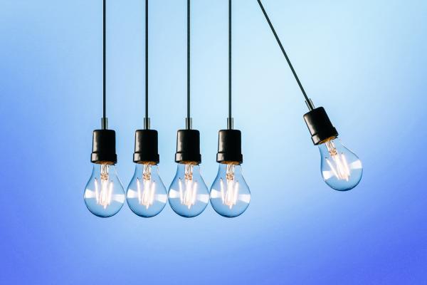 newton's cradle made of light bulbs
