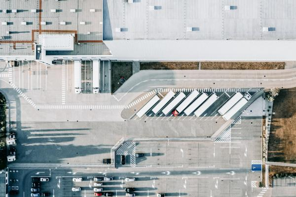 birds eye view of lorries parked at factory