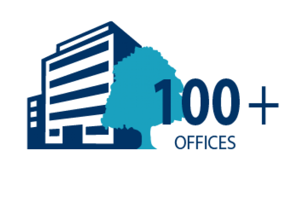 Graphic image of an office and a tree and the words: 100+ offices