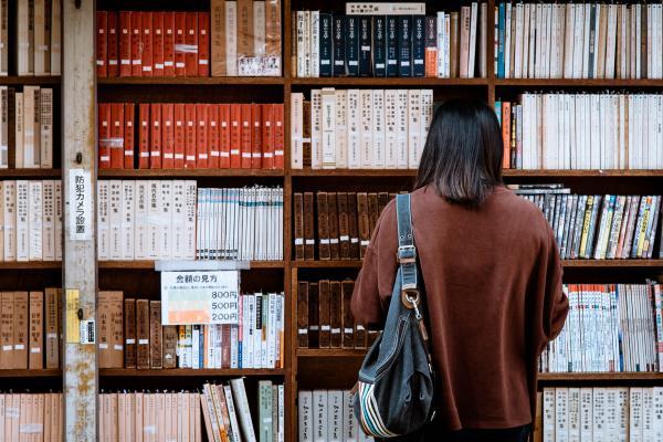 woman browing bookshop