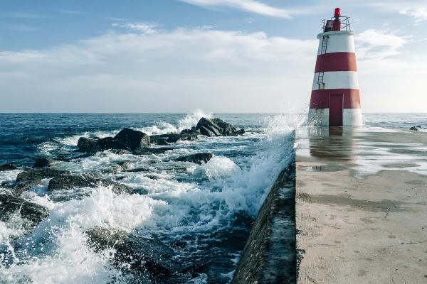 lighthouse next to waves