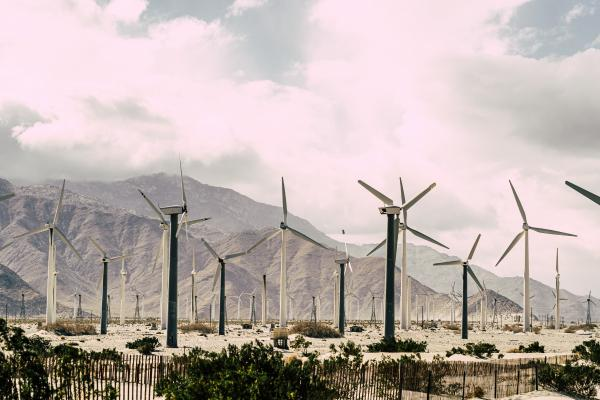 wind turbines with mountains in background